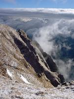 Undeva acolo-s Munții Baiului (vedere de sub Caraiman).