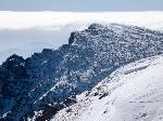 Puțin ĂŽnainte de ieșirea din Comorile ClĂŁii ĂŽn Platoul Bucegilor: vedere spre fostul Canton Schiel (centru-jos)